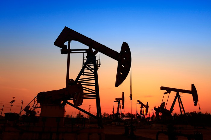 Oil wells at sunset.