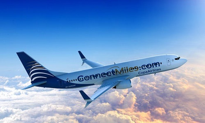A Copa Airlines plane, flying above the clouds
