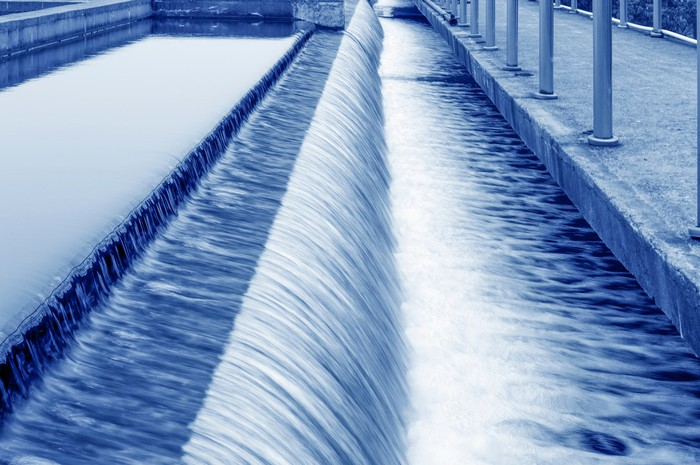 Water flowing over a dam in a treatment plant.