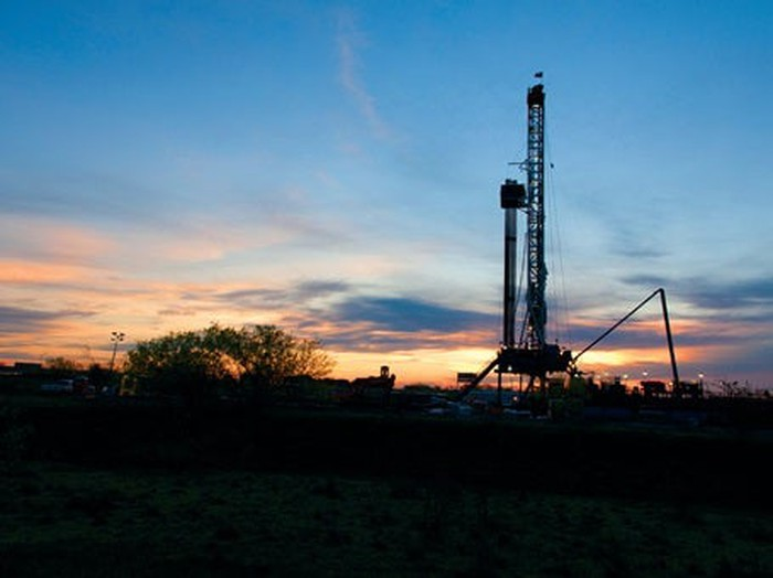 Drilling rig in silhouette