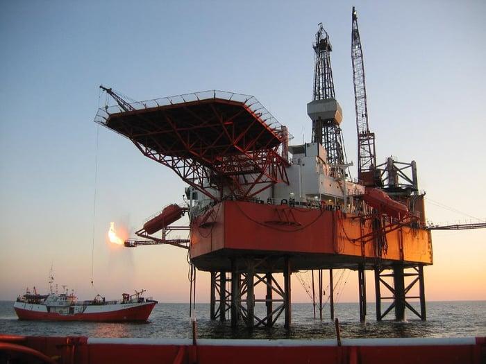 Jack-up rig on site with tender vessel