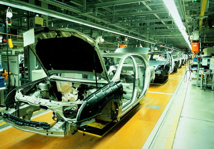 Cars in production on an assembly line