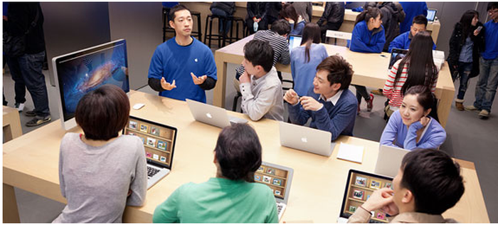 Image of people inside an Apple store.
