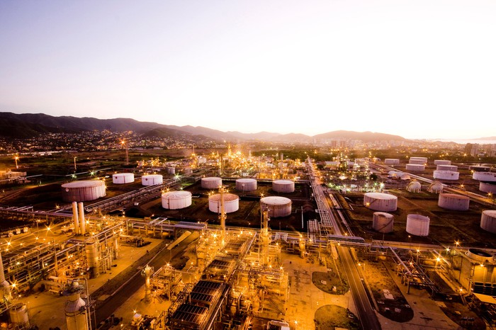 Oil refinery storage containers and pipeline infrastructure.