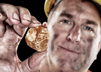 gold mining miner nugget man barrick goldcorp getty
