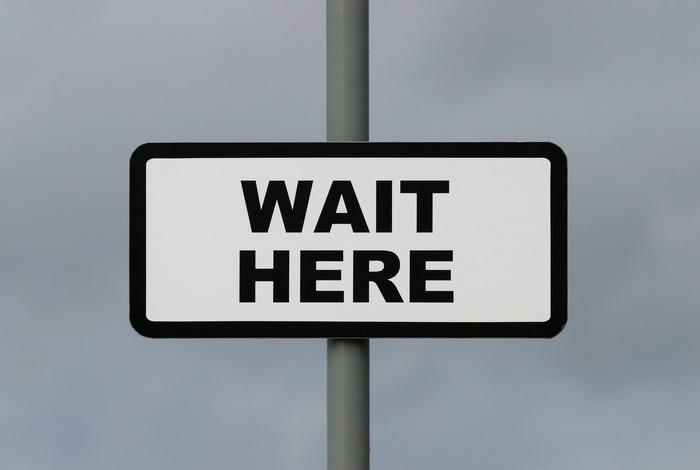 """Sign that says, """"wait here"""""""