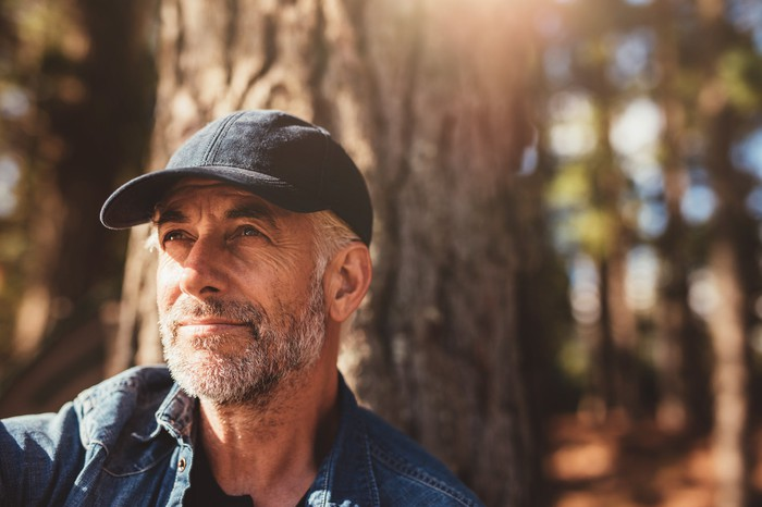 Older man wearing a baseball cap outdoors