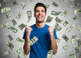 money raining on man smiling rich