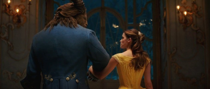 """Scene from """"Beauty and the Beast"""" -- two title characters walking arm-in-arm, as shown from behind."""