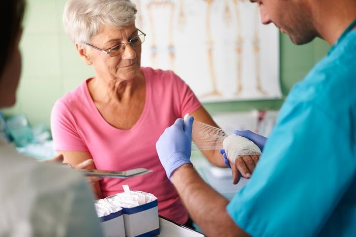 Senior woman getting medical treatment.
