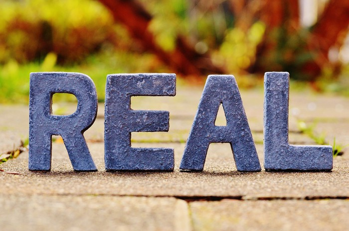 "The word ""real"" in 3-d letters"