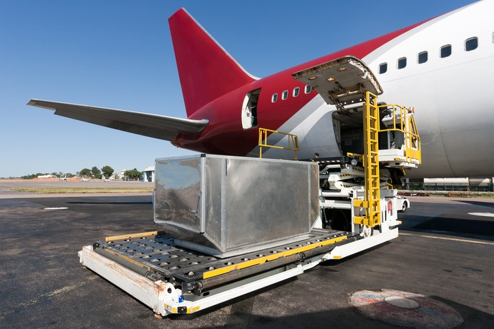 Cargo being loaded onto a cargo airplane