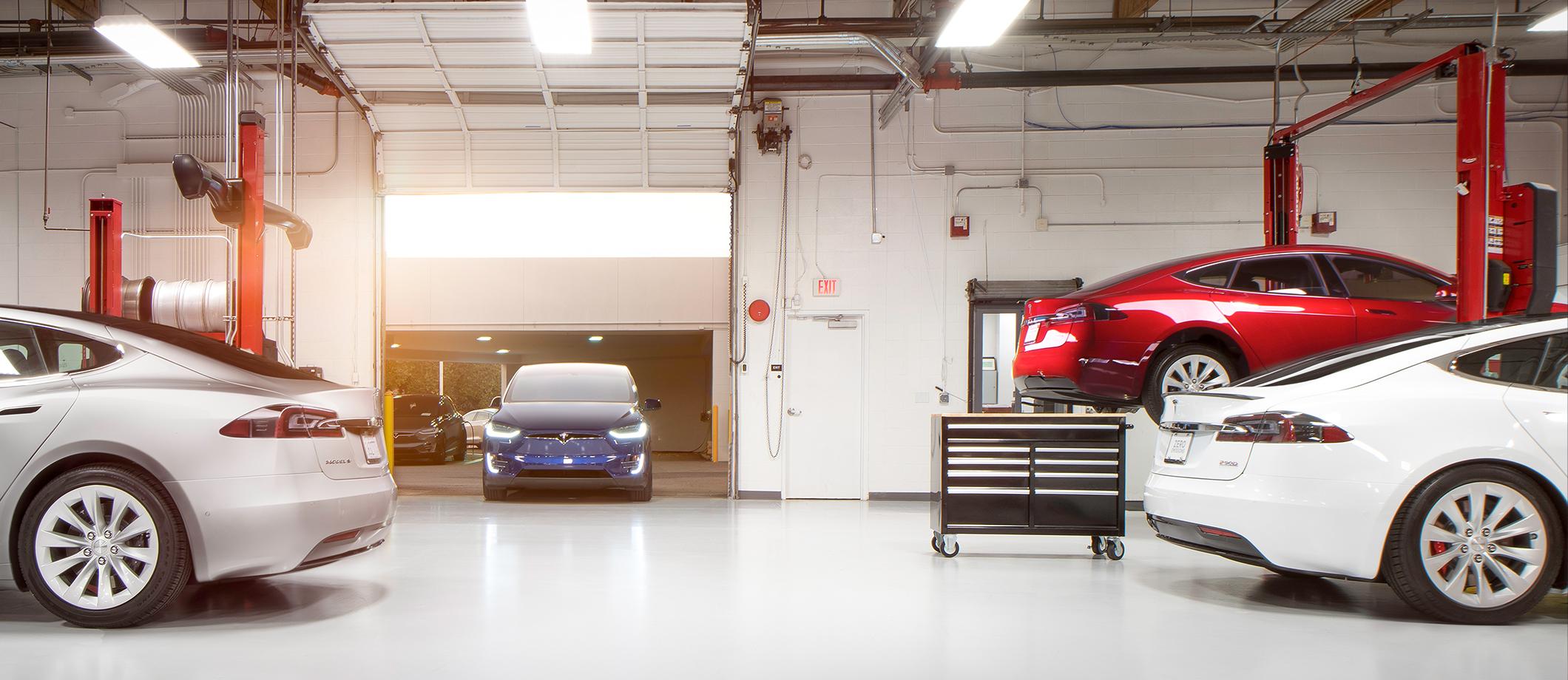 Tesla vehicles inside a service center