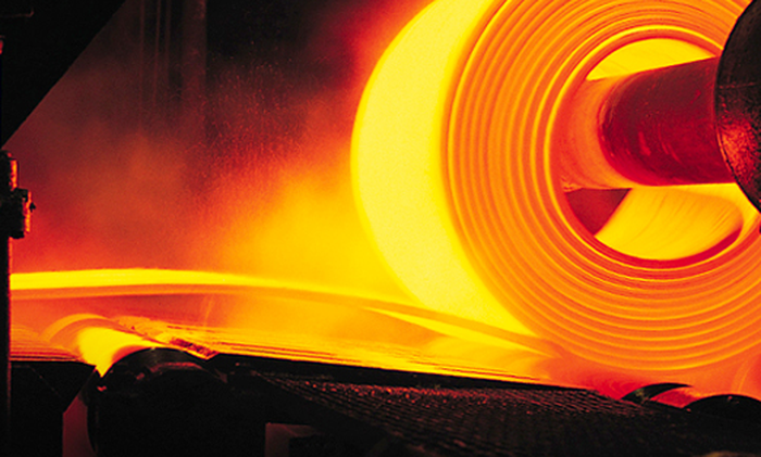 A hot roll of metal in a Nucor steel mill.