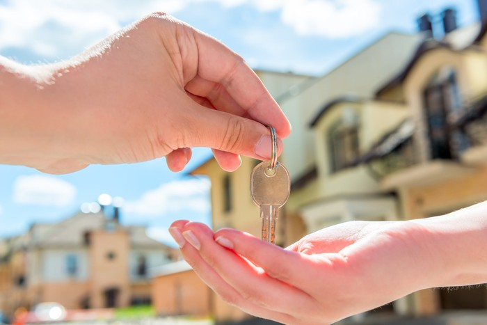 Transferring the key to a buyer.