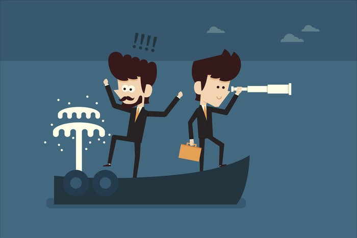 Vector illustration of two businessmen on a leaky boat.