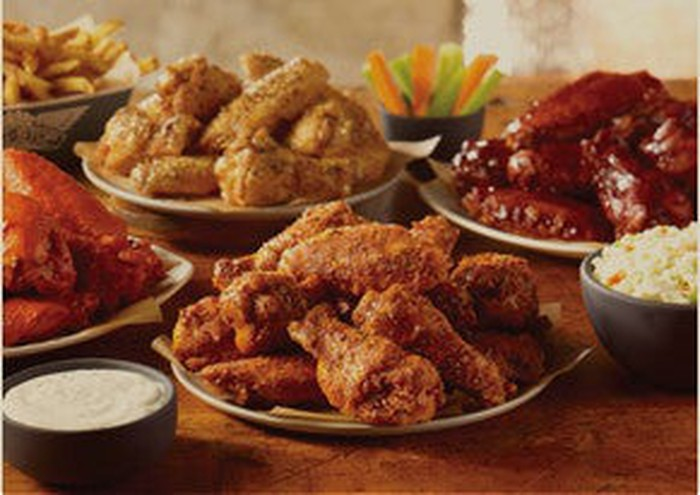 Various plates of chicken wings from Wingstop.