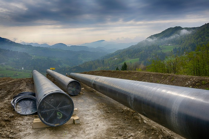 Construction of a pipeline in the mountains.