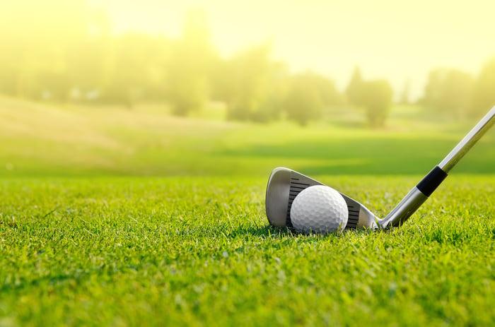 Golf club addressing a ball on the fairway.