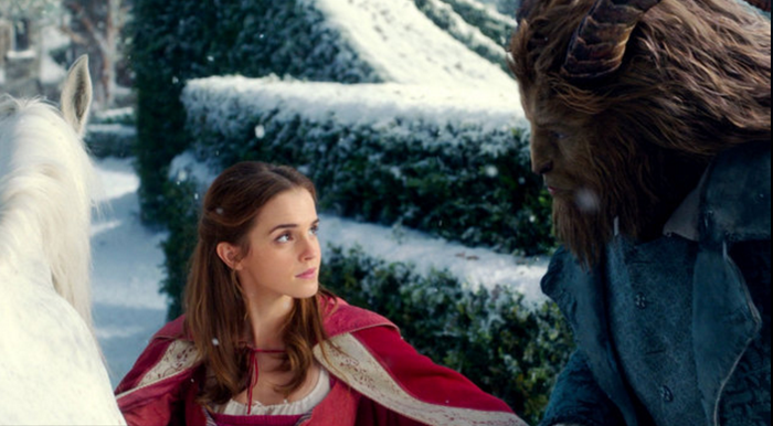 "Scene from ""Beauty and the Beast"" showing two title characters looking at each other while outside."