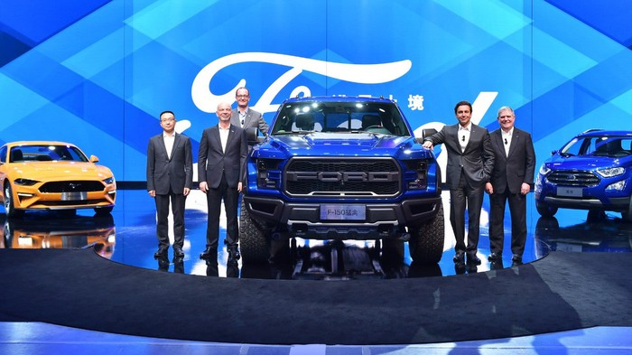 Ford executives surround the 2017 Raptor on a stage in China.
