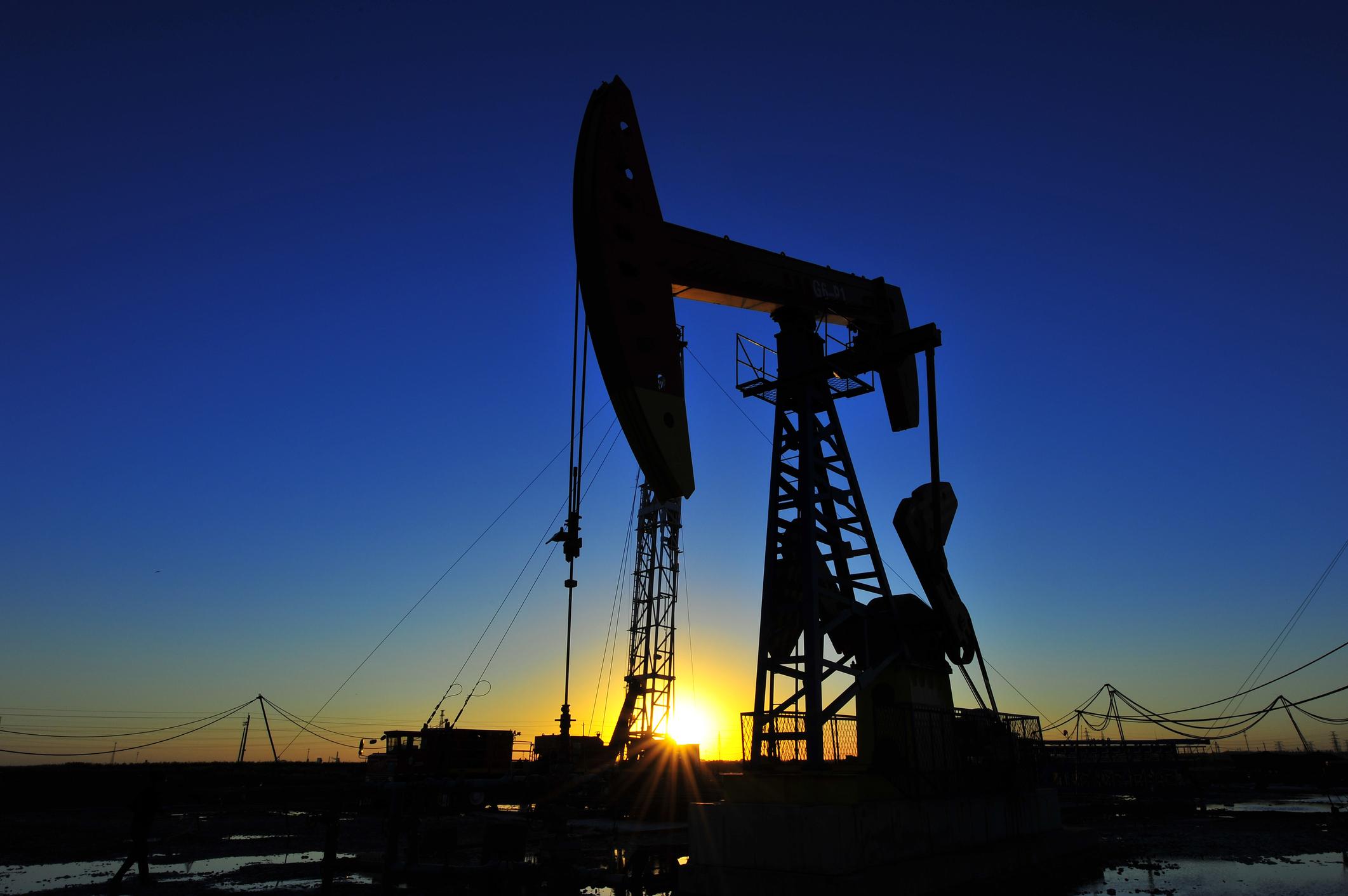 An oil pump at sunrise.