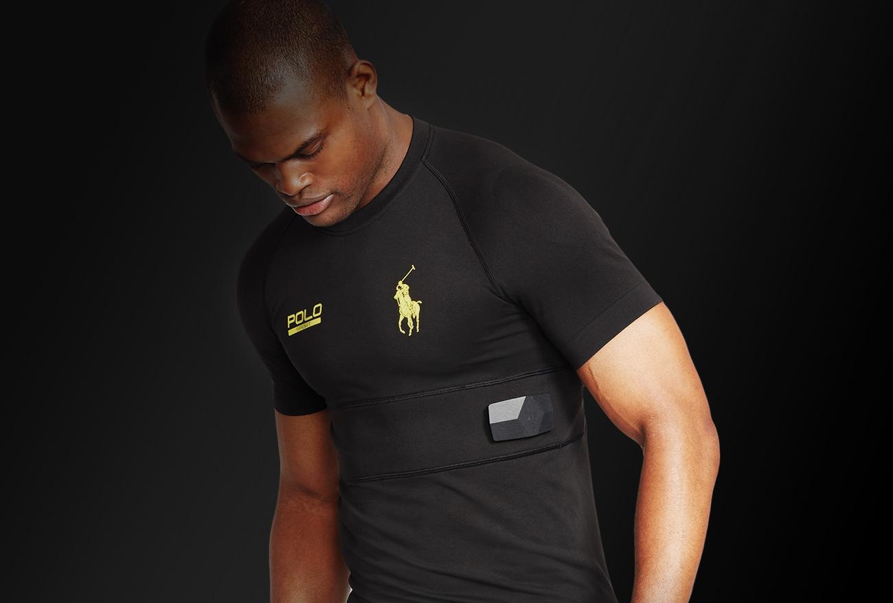 A man wearing a shirt with an embedded sensor.