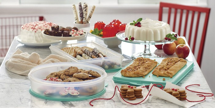 Tupperware containers filled with fall treats.