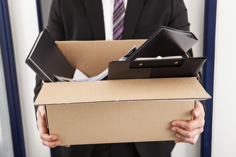 man holding box of work stuff
