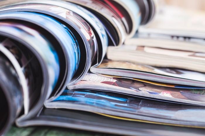 Pile of open magazines.