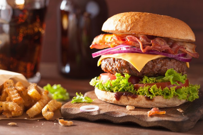 Picture of a burger with fries.