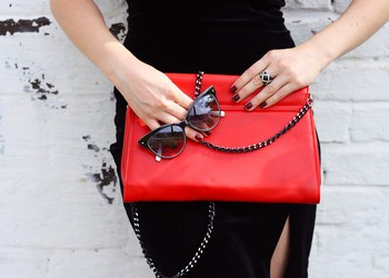 Handbag Woman Posing With Purse and Sunglasses in Hands