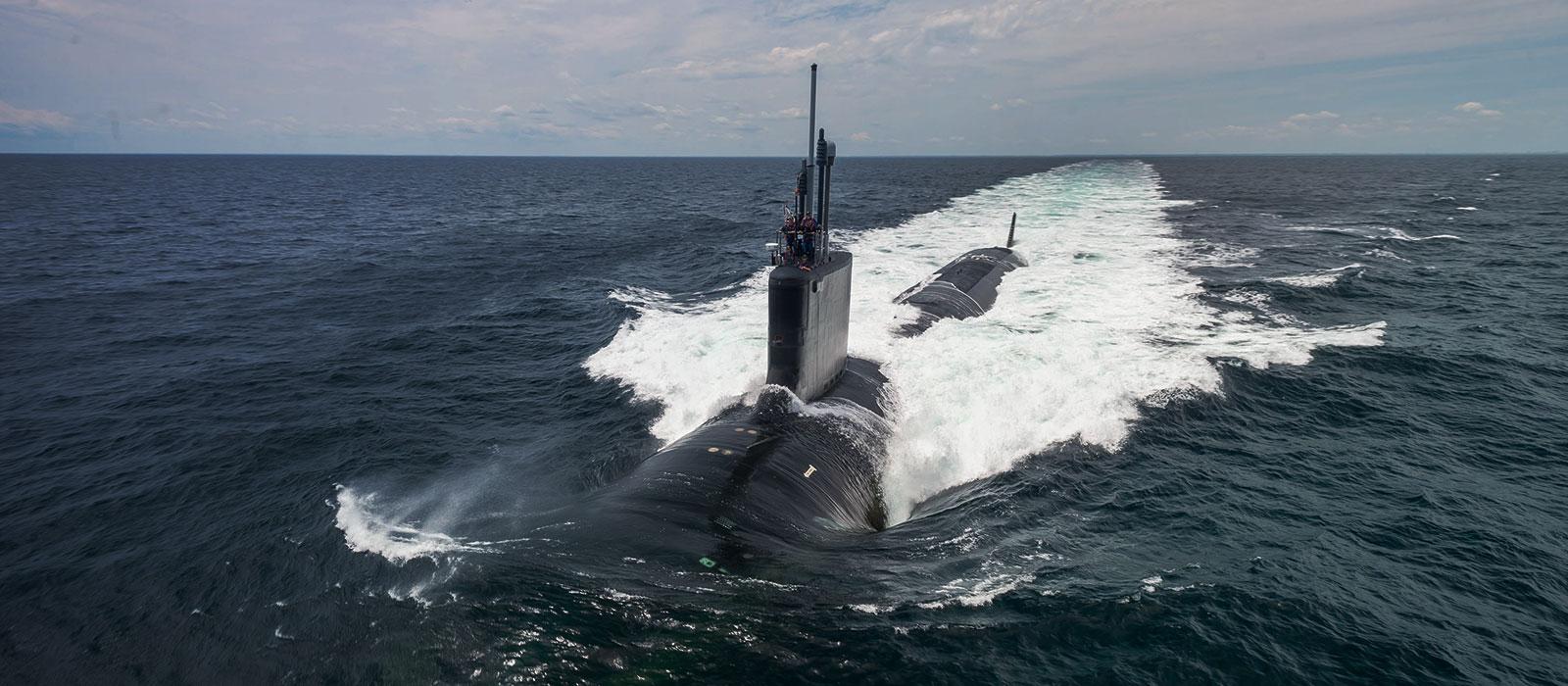 Submarine USS John Warner (SSN 785) half-submerged in the ocean