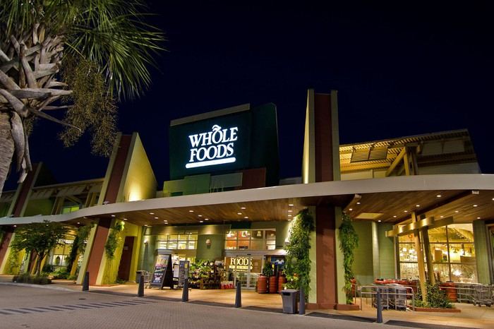 Night exterior shot of a Whole Foods store.