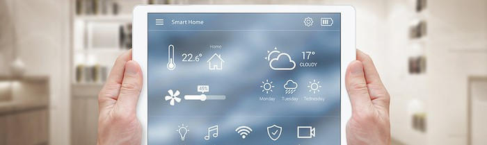 Two hands hold out a tablet, with a weather app on the screen.