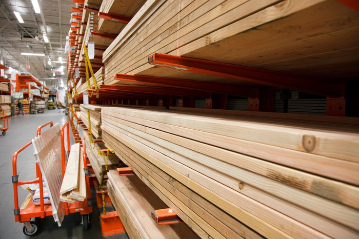 Lumber stacked in a a home improvement store.