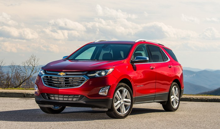 A red Chevy Equinox crossover in a sunny outdoors setting