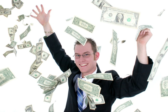 Man in suit throwing money in the air