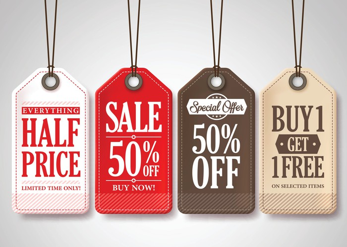 A group of multi-colored sales tags reading 50% off, half off, and buy-one-get-one-free.
