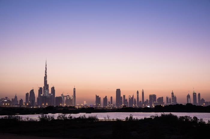 Dubai skyline at sunset.