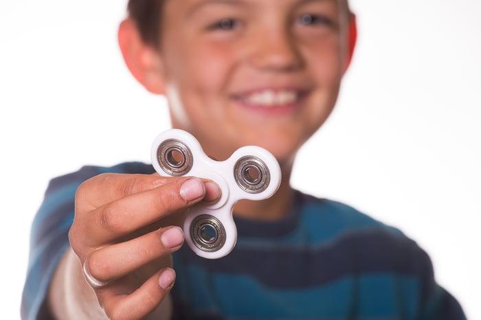 Boy holding a fidget spinner