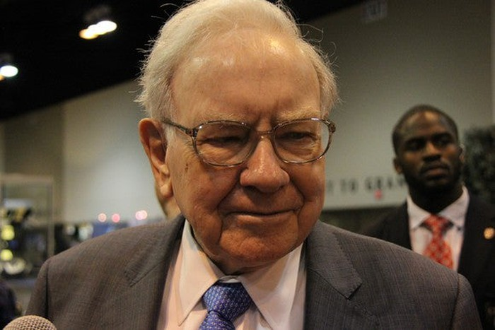 Warren Buffett meets with people at an industry conference.