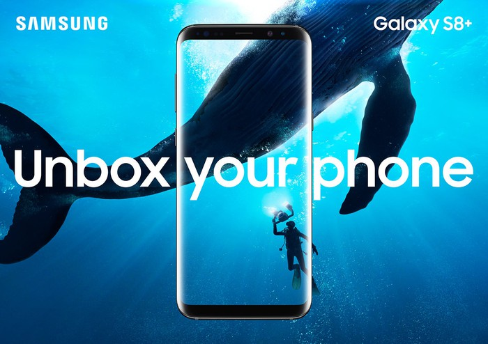 Undersea picture of a whale and diver with the Galaxy S8+ overlaid on top of it.