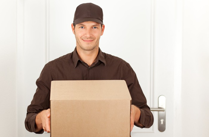 A man delivering a package.