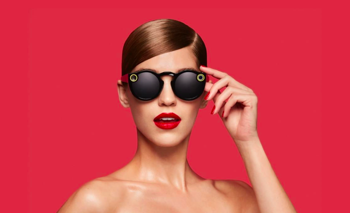 Woman wearing Snap Spectacles.