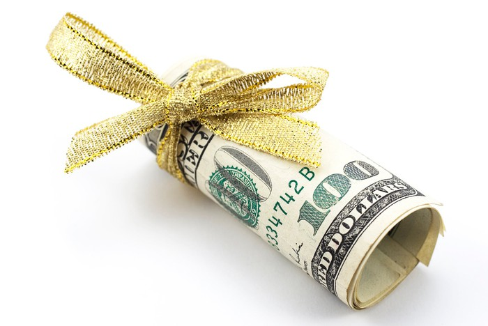 A roll of cash wrapped in a bow.