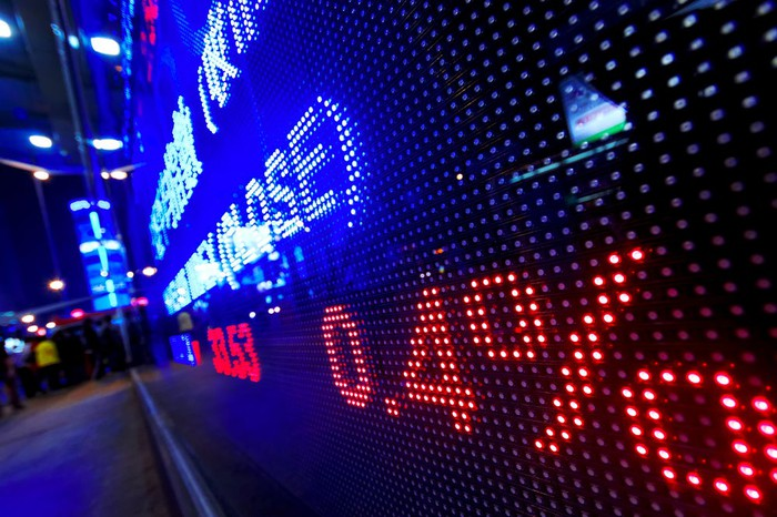 Wall Street electronic trading board at night.