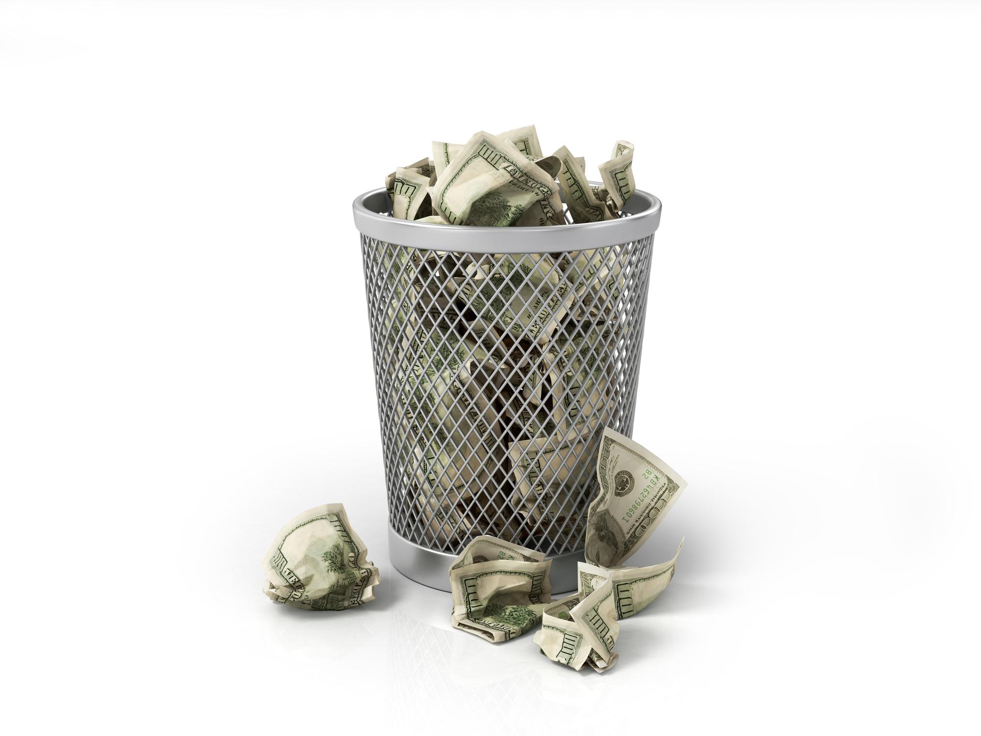 Money in wastebasket
