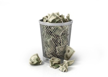 Money in wastebasket
