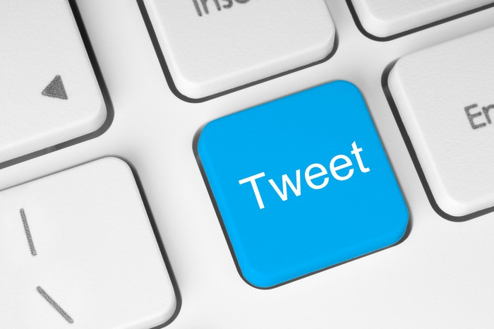 "A blue ""tweet"" button on a keyboard."